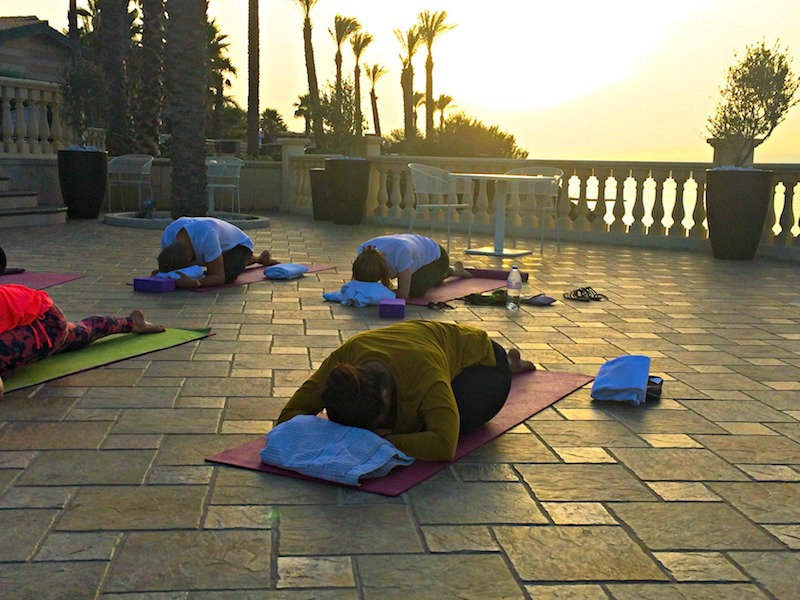 sunset yin yoga on a luxury yoga retreat