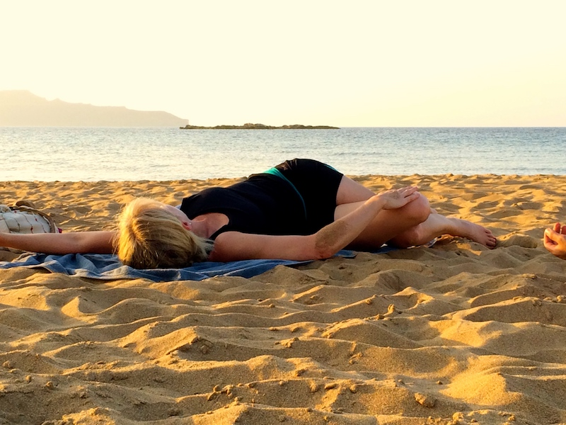 twists on the beach on a luxury yoga retreat