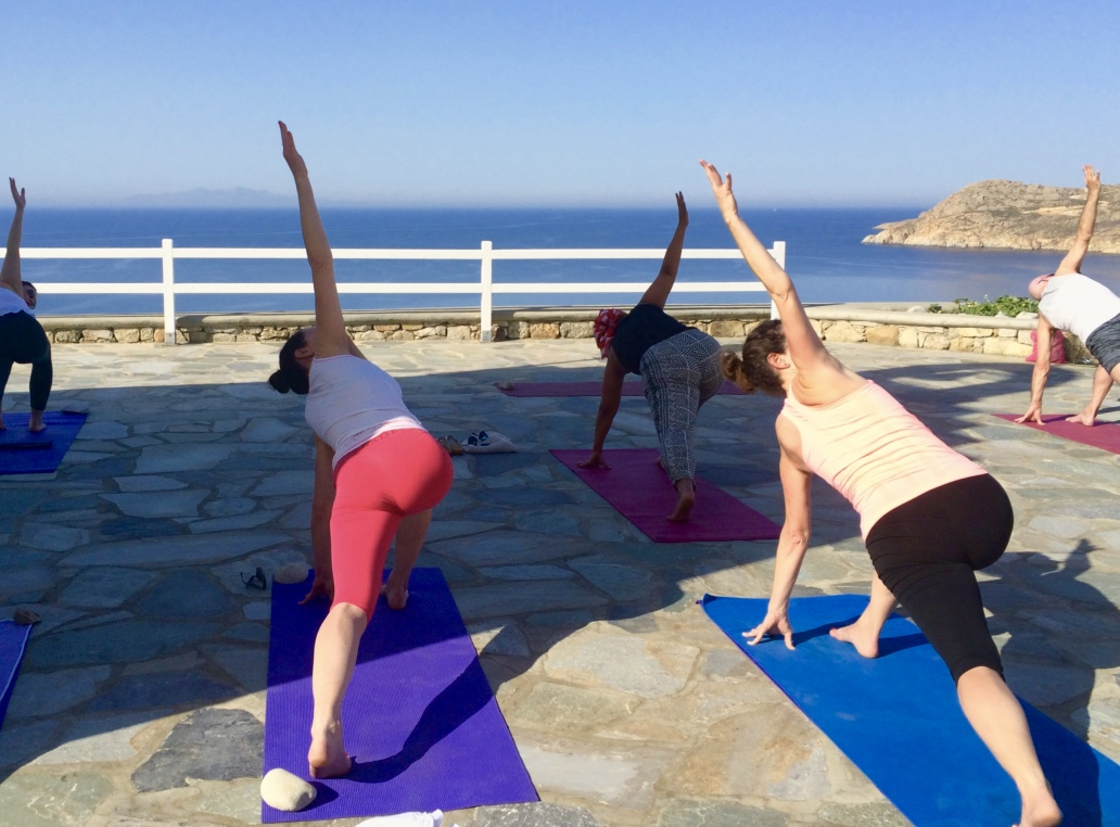 yoga class in mykonos greece by the sea