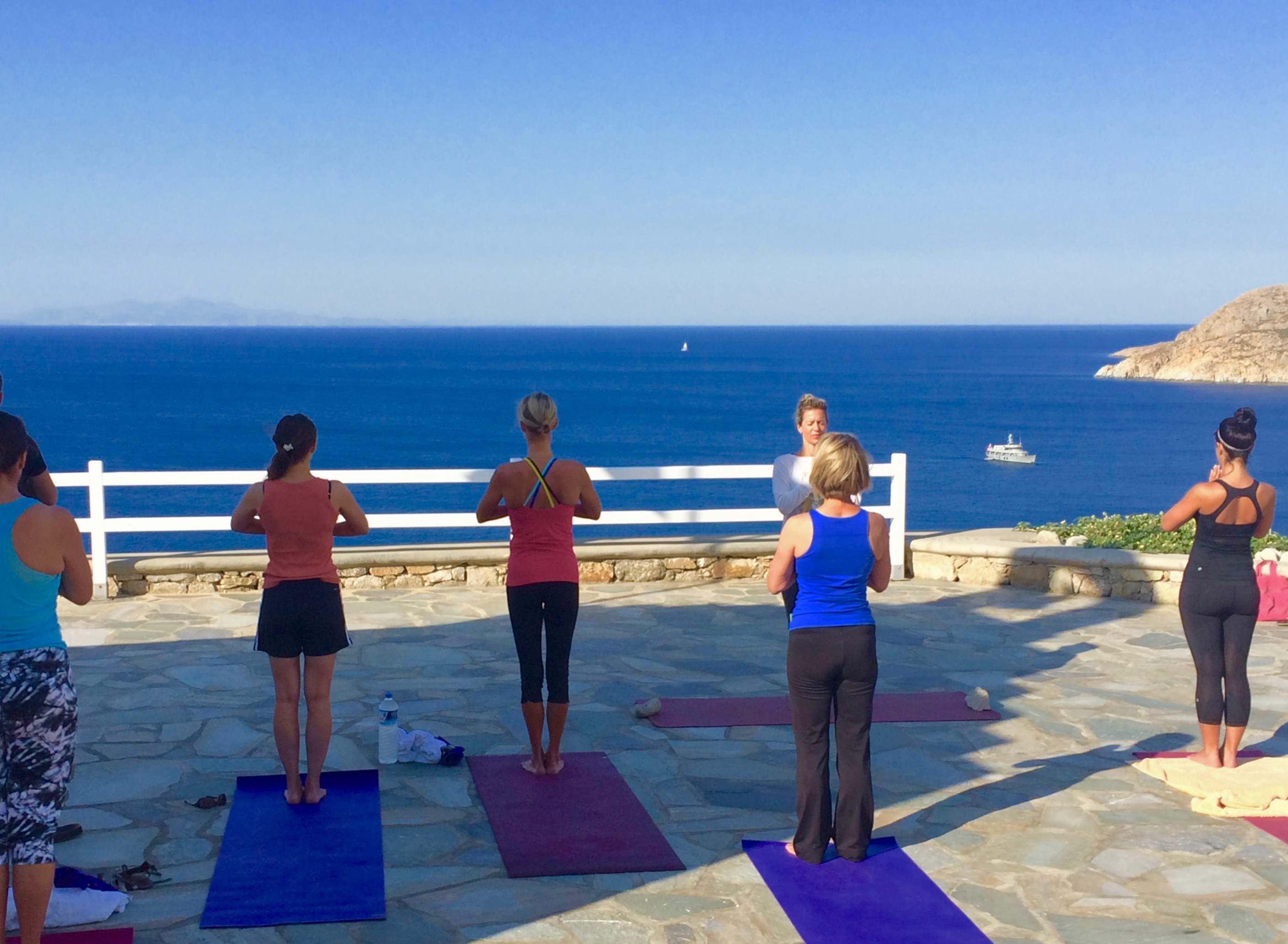 yoga class by the sea in mykonos greece