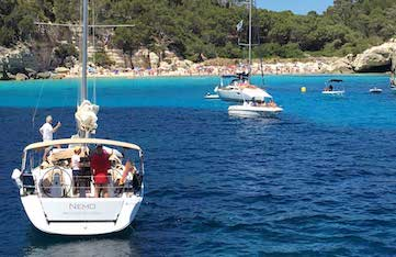sailing in menorca spain with yoga escapes